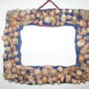 Okvir iz školjkic,ki jih je Nina nabrala na morju+das masa